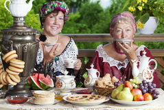 Two women drinking tea Stock Photos
