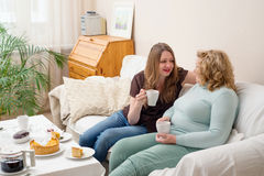 Two women drinking tea and talking. Mother and daughter. Royalty Free Stock Photos