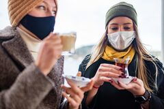 Free Two Women Drinking Turkish Tea And Salep While Wearing Medical Mask Coronavirus Time Royalty Free Stock Photo - 217619485