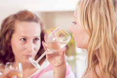 Two women drinking wine Stock Photos