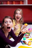 Two women with Easter eggs look surprised Royalty Free Stock Photos