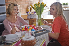 Two women eating Easter breakfast Royalty Free Stock Photography