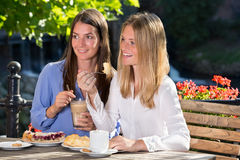 Two women eating in outdoor cafe Royalty Free Stock Photo