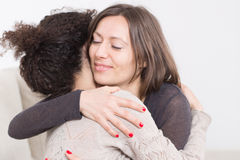 Two Women Embrace Each Other Royalty Free Stock Photography