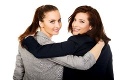 Two women embracing each other. Stock Images