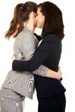 Two women embracing each other. Stock Image