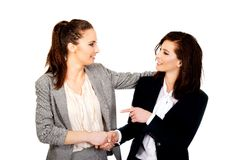 Two women embracing each other. Royalty Free Stock Photography