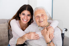 Two Women Embracing Each Other At Home Stock Photos