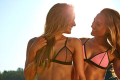 Two Women Enjoying Beach Holiday Stock Photo