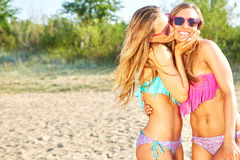 Two Women Enjoying Beach Holiday Stock Image