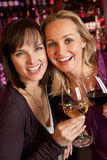 Two Women Enjoying Drink Together In Bar Royalty Free Stock Photography