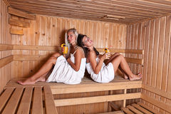 Two women enjoying a hot sauna Royalty Free Stock Photo