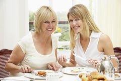 Two Women Enjoying Hotel Breakfast Stock Photography