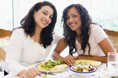 Two women enjoying a meal together Royalty Free Stock Photos