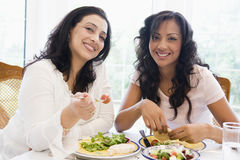 Two women enjoying a meal together Stock Photography