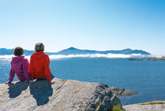 Two women enjoying view at fjord Stock Photography