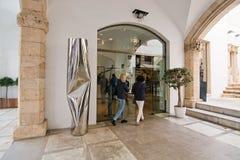 Two women enter Galeria K Royalty Free Stock Image