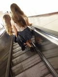 Two women on the escalator Stock Images