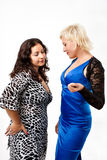 Two women estimate a breast Royalty Free Stock Photo