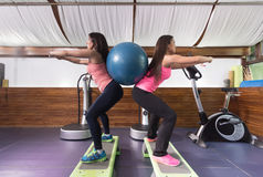 Two women exercise gym lunge ball weightsgym exercise ball Stock Photos