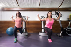 Two women exercise  one leg lunge resistance band Stock Images