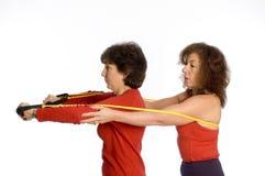 Two women exercising royalty free stock photo