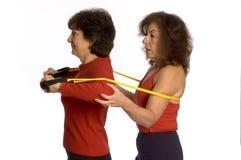 Two women exercising royalty free stock image
