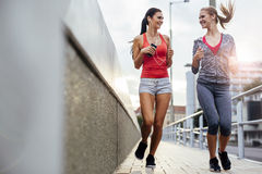 Two women exercising by jogging Stock Photography