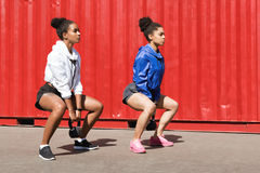Two women exercising with kettlebell Stock Image