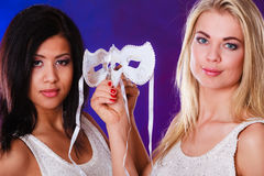Two women face with carnival venetian masks Stock Images