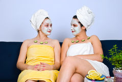 Two women with facial mask at spa salon Royalty Free Stock Photography
