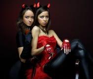 Two women in fancy dress Stock Image