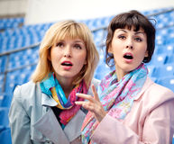 Two women fans watching  competition Royalty Free Stock Image