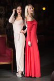 Two women Fashion model wearing evening gown, club Royalty Free Stock Photos