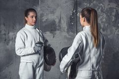 Two women fencing Royalty Free Stock Photos