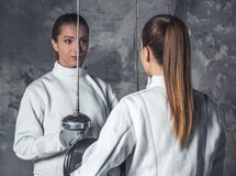 Two women fencing Royalty Free Stock Image