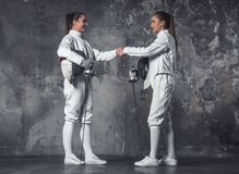 Two women fencing Stock Image