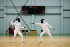 Two women on a fencing training Royalty Free Stock Photos