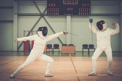 Two women on a fencing training Stock Photography