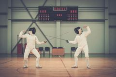 Two women on a fencing training Royalty Free Stock Image