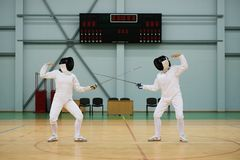 Two women on a fencing training Stock Photo