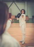Two women on a fencing training Stock Photos