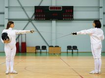 Two women on a fencing training Royalty Free Stock Photo