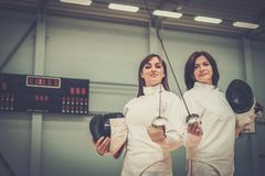 Two women on a fencing training Stock Images