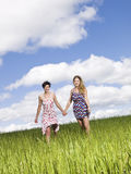 Two women on a field Stock Photography