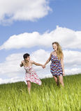 Two women on a field Royalty Free Stock Photography