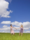 Two women on a field Royalty Free Stock Photo