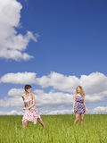 Two women on a field Stock Images