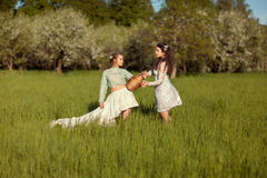 Two women in the field. Royalty Free Stock Image