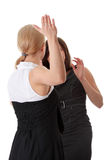 Two women fight. Isolated on white background stock photo